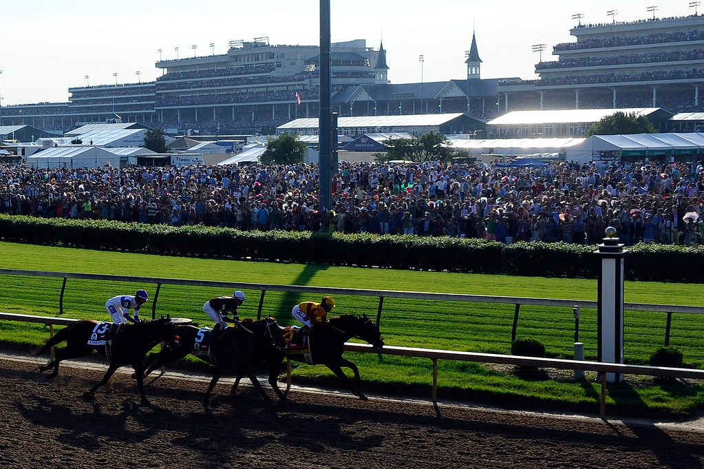 . Nyquist #13, ridden by Mario Gutierrez, Gun Runner #5, ridden by Florent Geroux, and Danzing Candy #20, ridden by Mike E. Smith, head into the third turn during the 142nd running of the Kentucky Derby at Churchill Downs on May 07, 2016 in Louisville, Kentucky.  (Photo by Logan Riely/Getty Images)