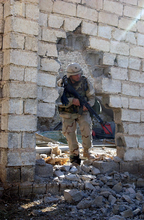 . A picture released by the US Army shows a US Soldier from 2nd Battalion, 5th Cavalry Regiment, 2nd Brigade Combat Team, 1st Cavalry Division, moving through the rubble of a building as he enters and clears his objective  in the restive Sunni Muslim city of Fallujah, west of Baghdad, 09 November , 2004, during Operation Al Fajr (New Dawn). US-led forces have control of almost the whole of Fallujah but it will still take some time before the rebel enclave is secure, a US marine spokesman said, 12 November 2004   AFP PHOTO/ Sgt. 1st Class Johancharles Van Boers/ U.S. Army  (Photo credit Sgt. 1st Class Johancharles Van/AFP/Getty Images)