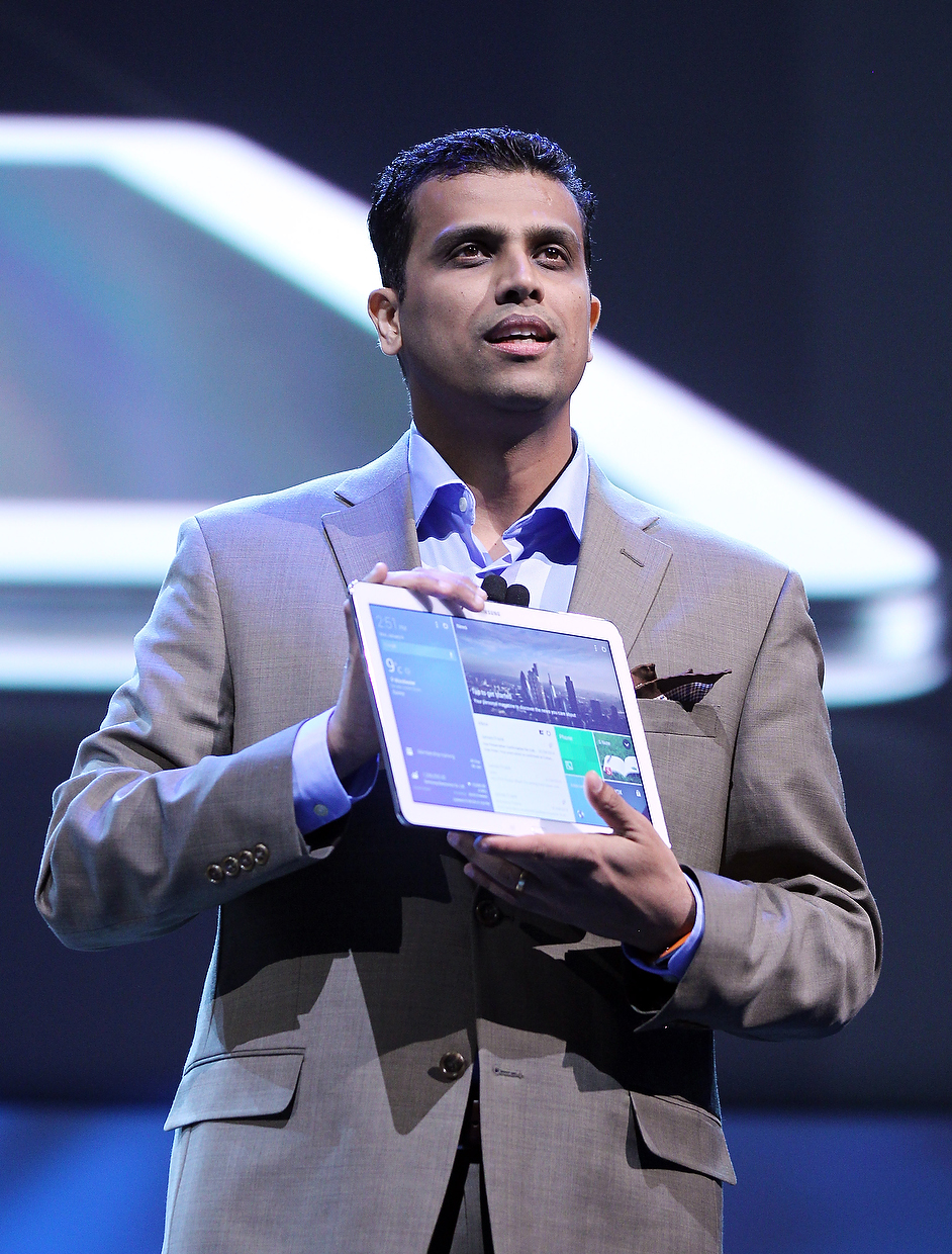 . Vice President Samsung Telecommunications America Nanda Ramachandran introduces the Galaxy Tab Pro tablet computer during a news conference at the International Consumer Electronics Show, Monday, Jan. 6, 2014, in Las Vegas. (AP Photo/Isaac Brekken)