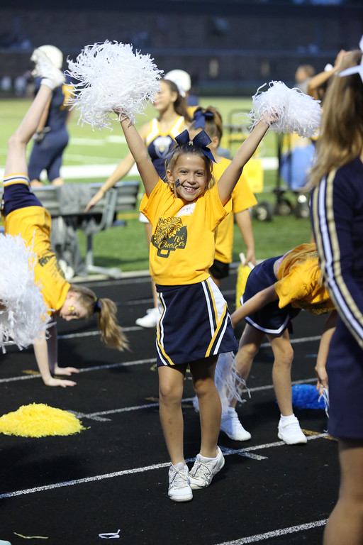 ". David Schneider - The Morning Journal<br> Paige Blaylock of North Ridgeville cheers alongside the Rangers\' cheerleaders during the second quarter as part of ""Future Cheerleaders,\"" a group of pre-school through 6th graders."