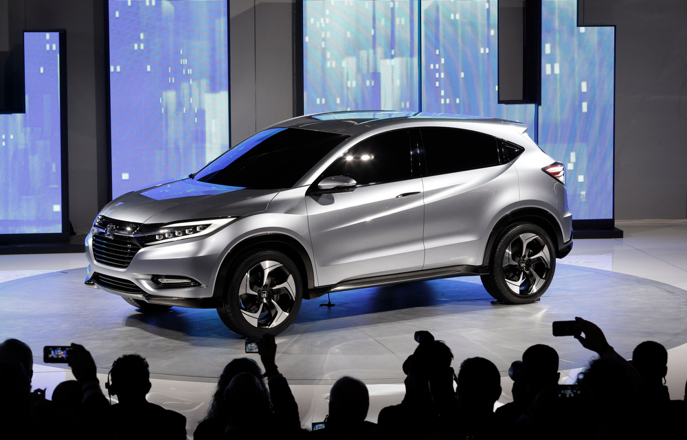 . The Honda Urban SUV Concept is shown at media previews for the North American International Auto Show in Detroit, Monday, Jan. 14, 2013.  (AP Photo/Paul Sancya)