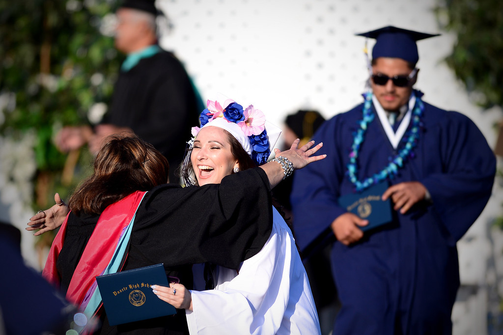 . Sophia Camp hugs faculty after receiving her diploma during Duarte High School\'s commencement ceremony Thursday night,  June 12, 2014 at the Duarte school. (Photo by Sarah Reingewirtz/Pasadena Star-News)