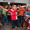 Children participate in a dance class.