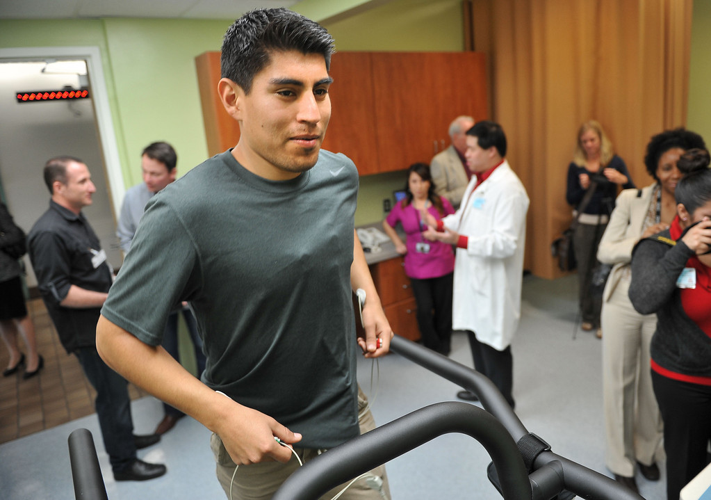 . 2/14/13 - Javier Ramos performs a treadmill test while guests tour   the new cardiopulmonary lab at the Long Beach Comprehensive Health Center.  The new lab was funded by more than $6000,000 grant from the Port of Long Beach Community Mitigation Grant Program.  According to Associate Medical Director Dr. Tyler Seto this will allow community members to have tests done within weeks instead of up to six months using other labs. Photo by Brittany Murray / Staff Photographer