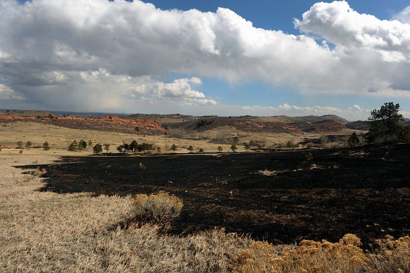 . FORT COLLINS, CO- MARCH 17:  The Galena fire burned close to the Visitor\'s Center at the north end of Lory State Park, seen in the distance.  Calmer weather conditions helped keep the Galena Fire west of Fort Collins in check today March 17th, 2013.  The fire stands at 45% containment but moisture is expected in the late afternoon which should help firefighters. . (Photo By Helen H. Richardson/ The Denver Post)
