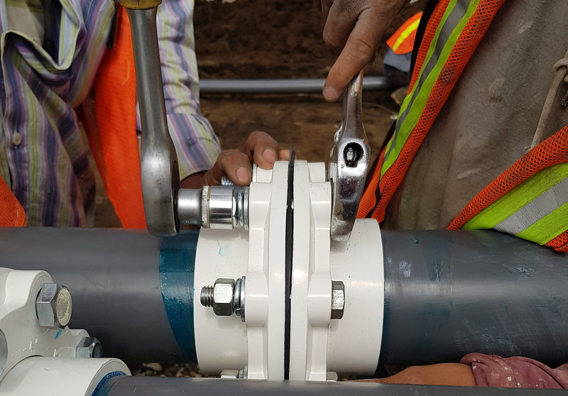 Contractor joining pipes and valves