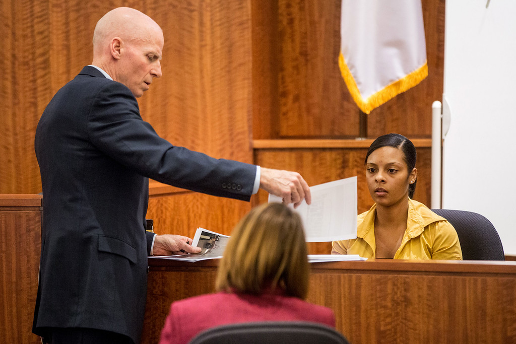 . Assistant district attorney William McCauley, left, questions Shaneah Jenkins, right, during the murder trial of former New England Patriots player Aaron Hernandez at Bristol County Superior Court in Fall River, Mass., Tuesday, Feb. 3, 2015. Hernandez is accused of the June 2013 killing of Odin Lloyd. (AP Photo/The Boston Globe, Aram Boghosian, Pool)