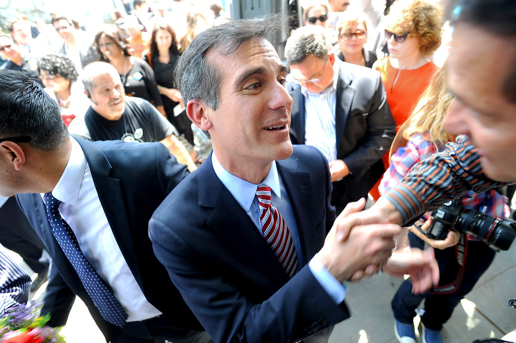 . Eric Garcetti talks with supporters after holding a press conference at El Centro del Pueblo in Echo Park, CA May 22, 2013.  Eric Garcetti won the mayoral runoff Tuesday in Los Angeles.(Andy Holzman/Staff Photographer)
