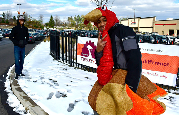 11/17/2018 Mike Orazzi | Staff New Britain High School students Elian Collado and Borjan Esquea during a FoodShare turkey drive at the Costco in NEw Britain Saturday morning.