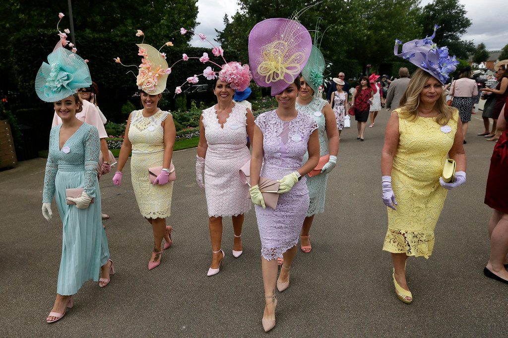 . Racegoers arrive on the first day of the Royal Ascot horse race meeting in Ascot, England, Tuesday, June 19, 2018. (AP Photo/Tim Ireland)