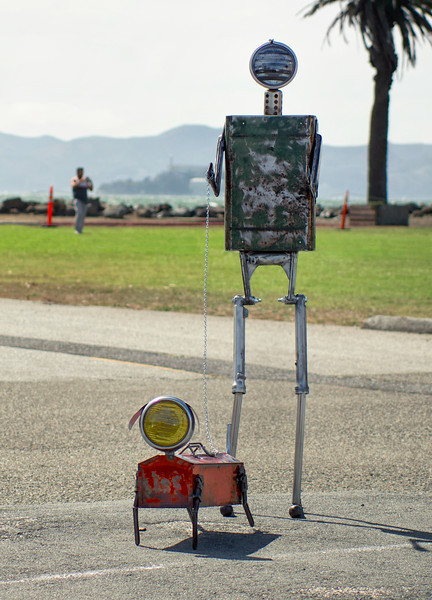 A robot walks his dog on Treasure Island.