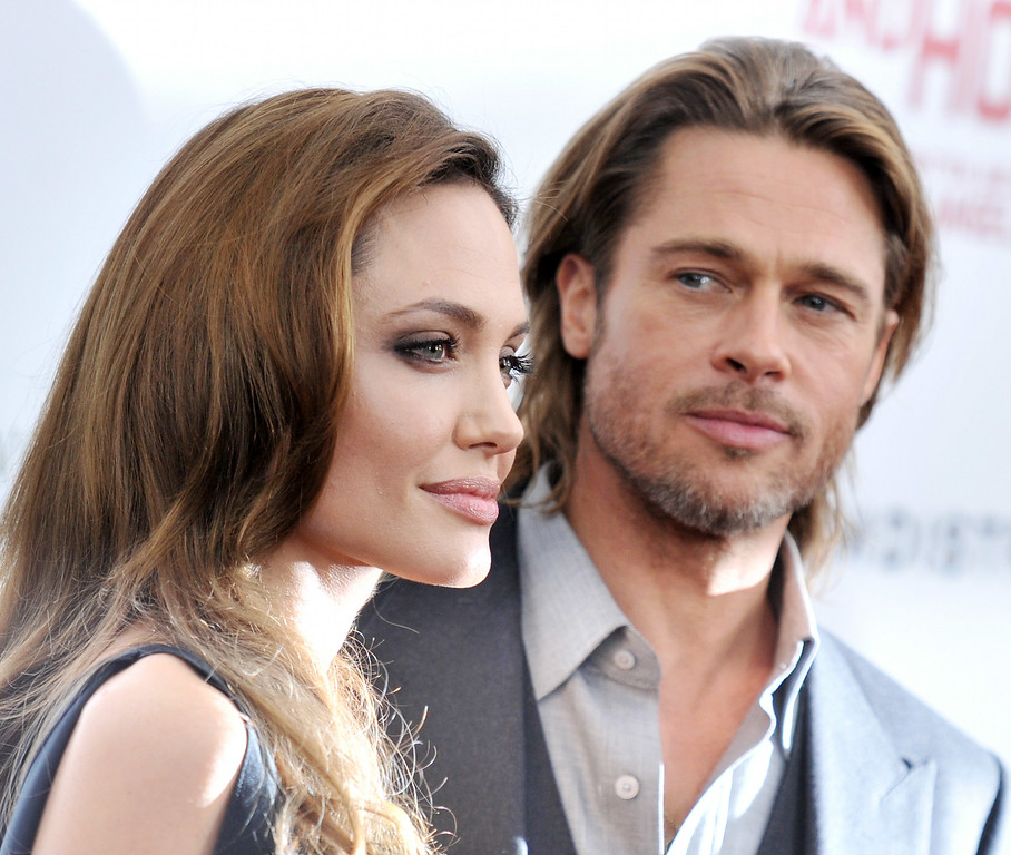 ". Angelina Jolie and Brad Pitt attend the premiere of ""In the Land of Blood and Honey\"" at the School of Visual Arts on December 5, 2011 in New York City.  (Photo by Stephen Lovekin/Getty Images)"