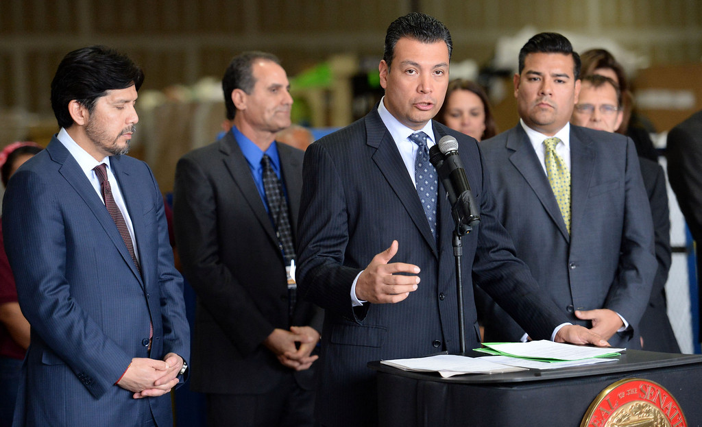 . Sen. Alex Padilla, D-Pacoima, center, along with Senator Kevin de Leon, left, D-Los Angeles and Senator Ricardo Lara, right, D-Huntington Park/ Long Beach announces the support for legislation to ban single use plastic bags during a press conference at Command Packaging in Vernon, Calif., on Friday, Jan. 24, 2014. (Keith Birmingham Pasadena Star-News)
