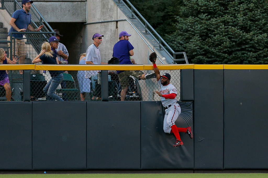 . DENVER, CO - JULY 22:  Center fielder Denard Span #2 of the Washington Nationals is unable to make a catch on a two run home run off the bat of Nolan Arenado (not pictured) of the Colorado Rockies during the third inning against the Colorado Rockies at Coors Field on July 22, 2014 in Denver, Colorado.  (Photo by Justin Edmonds/Getty Images)