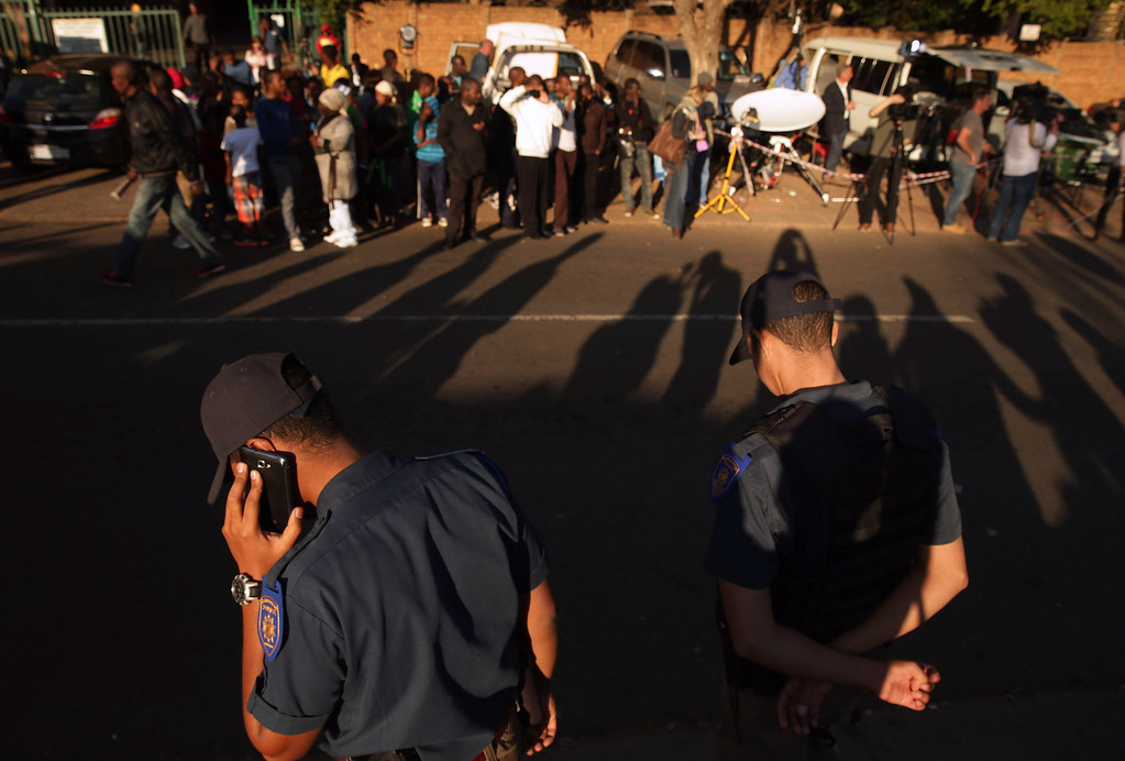 . PRETORIA, SOUTH AFRICA - JUNE 25:  Metropolitan Police keep order as people line the street outside of the Mediclinic Heart Hospital where former South African President Nelson Mandela is being treated June 25, 2013 in Pretoria, South Africa. South African President Jacob Zuma confirmed on June 23 that Mandela\'s condition has become critical since he was admitted to the hospital over two weeks ago for a recurring lung infection.  (Photo by Chip Somodevilla/Getty Images)