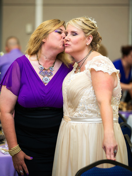 Bride Kissing Friend.jpg