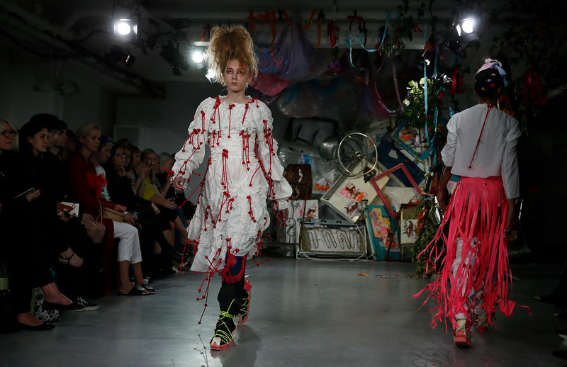 . A model wears an outfit by designers Meadham Kirchhoff for their Spring/Summer 2015 fashion collection at London Fashion Week in London, Tuesday, Sept. 16, 2014. (AP Photo/Alastair Grant)