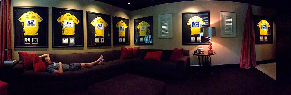 Description of . A picture posted by Lance Armstrong on his Twitter account on November 10, 2012 shows him laying on a couch with his seven Tour de France yellow jerseys in the background.  The picture was sent to Armstrong's 3.8 million Twitter followers under a message reading