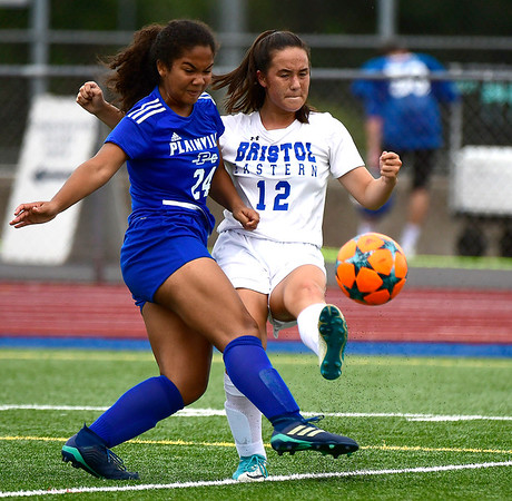 9/11/2018 Mike Orazzi | Staff Plainville's Jordan Thompkins (24) and Bristol Eastern's Leah Policarpio (12) during Tuesday's soccer at Plainville High School.