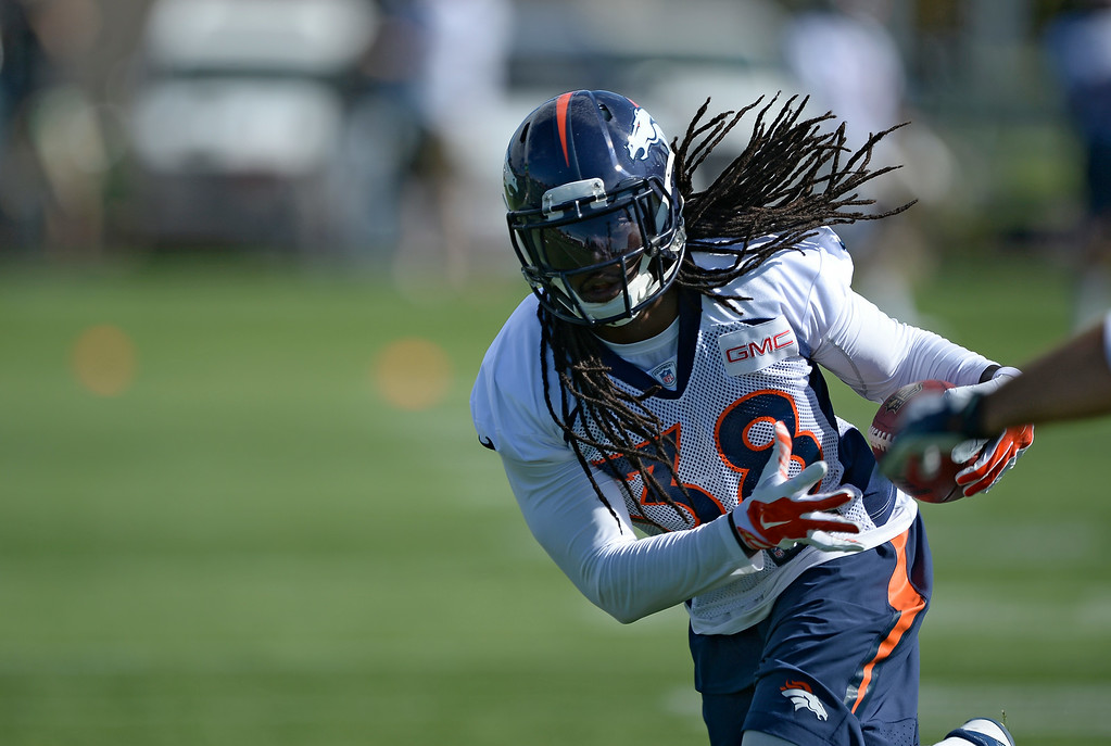 . Denver Broncos strong safety Quinton Carter (38) runs through drills during the first day of the Denver Broncos 2014 training camp July 24, 2014 at Dove Valley. (Photo by John Leyba/The Denver Post)