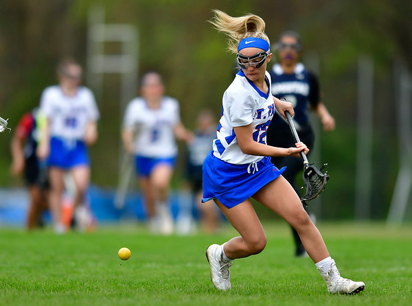 5/2/2019 Mike Orazzi | Staff St. Paul's Christina Pisani (12) during Thursday's girls lacrosse with Amistad in Bristol.