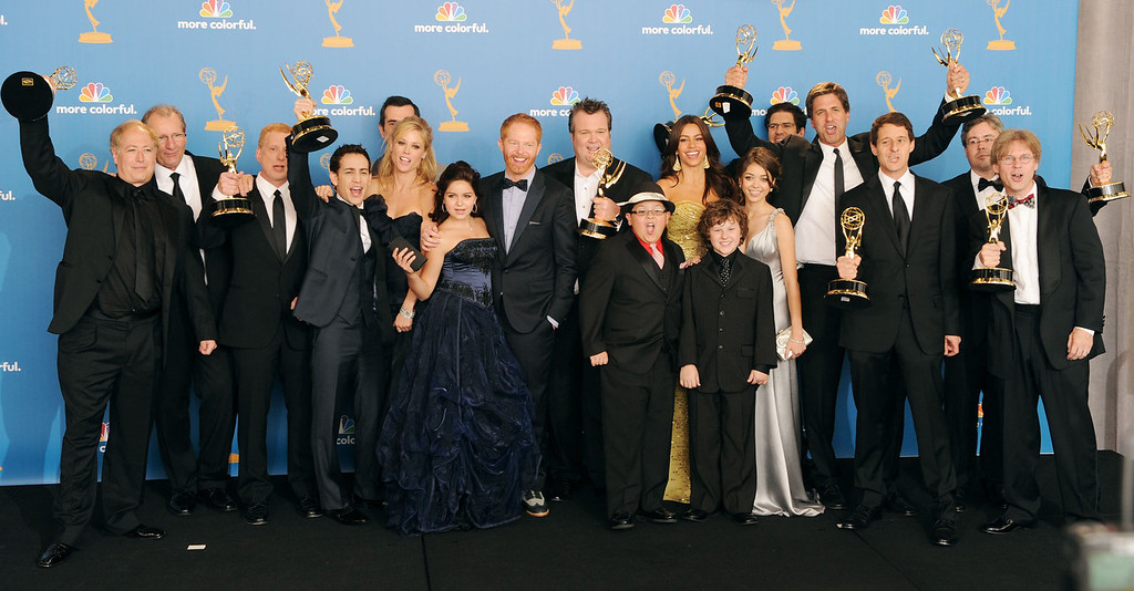 """. Cast and crew of \""""Modern Family\"""", winners of the Outstanding Comedy Series Award pose in the press room at the 62nd Annual Primetime Emmy Awards held at the JW Marriott Los Angeles at L.A. Live on August 29, 2010 in Los Angeles, California.  (Photo by Jason Merritt/Getty Images)"""