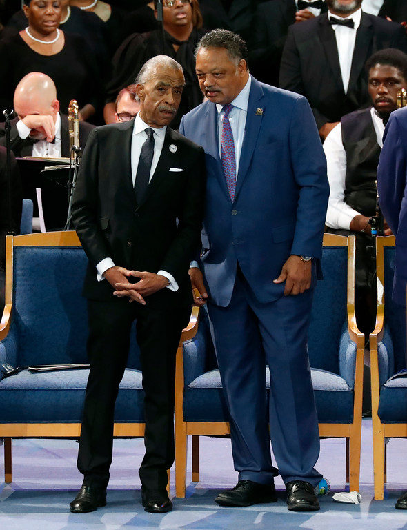 . Rev. Al Sharpton, left, talks with Rev. Jesse Jackson at the start of the funeral service for Aretha Franklin at Greater Grace Temple, Friday, Aug. 31, 2018, in Detroit. Franklin died Aug. 16, 2018 of pancreatic cancer at the age of 76. (AP Photo/Paul Sancya)