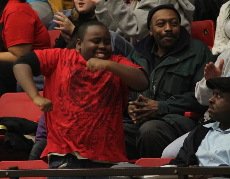 A child rejoicing over Gardner-Webb's leading score.