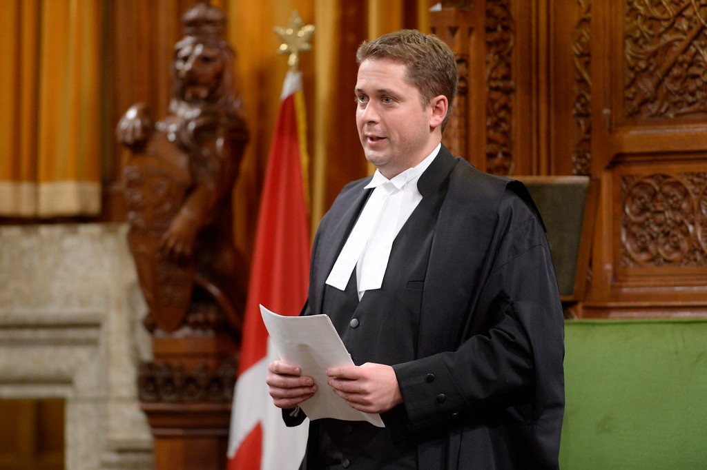 . Speaker of the House Andrew Scheer rises in the House of Commons on Parliament Hill in Ottawa on Thursday, Oct. 23, 2014. The House of Commons is back in action, kicked off by an exhilarating show of support for Sergeant-at-Arms Kevin Vickers, who was among those who opened fire on Michael Zehaf Bibeau, who stormed Parliament Hill on Wednesday. (AP Photo/The Canadian Press, Adrian Wyld)