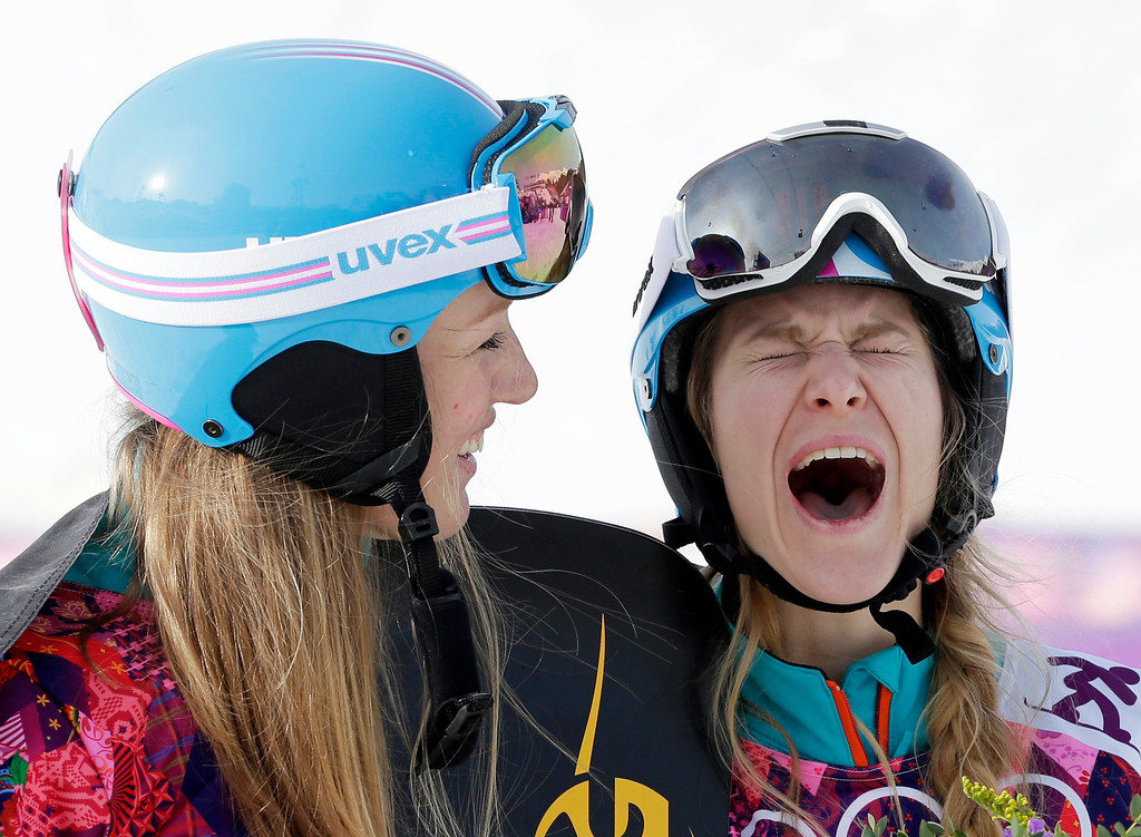 . Women\'s snowboard parallel slalom silver medalist Anke Karstens of Germany, left, and bronze medalist Amelie Kober of Germany celebrate at the Rosa Khutor Extreme Park, at the 2014 Winter Olympics, Saturday, Feb. 22, 2014, in Krasnaya Polyana, Russia. (AP Photo/Andy Wong)