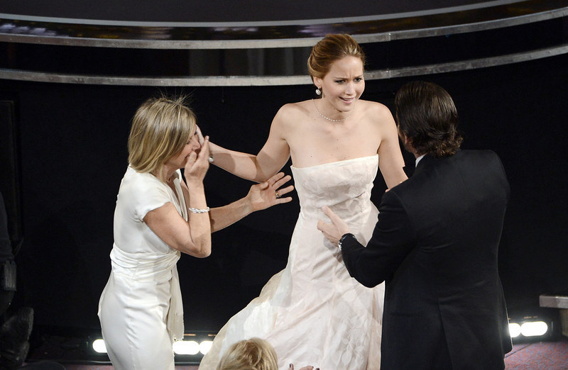 ". Actress Jennifer Lawrence (C), mother Karen Lawrence and actor Bradley Cooper (R) celebrate after Lawrence wins the Best Actress award for ""Silver Linings Playbook\"" during the Oscars held at the Dolby Theatre on February 24, 2013 in Hollywood, California.  (Photo by Kevin Winter/Getty Images)"