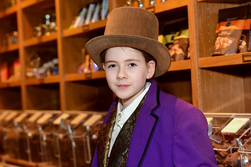 Traveling Players Ensemble Charlie in Candy Store