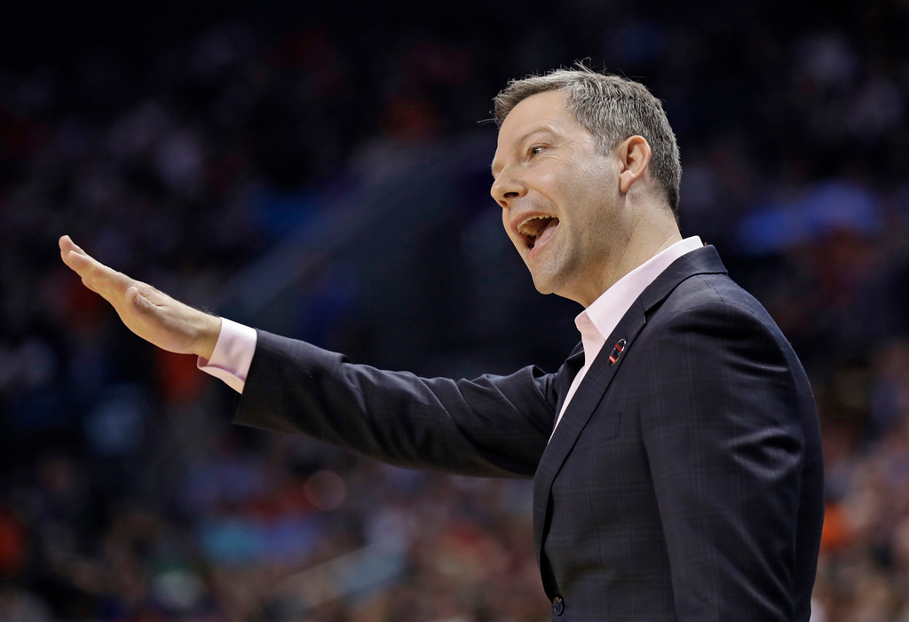 . UMBC head coach Ryan Odom gestures during the first half of the team\'s first-round game against UMBC in the NCAA men\'s college basketball tournament in Charlotte, N.C., Friday, March 16, 2018. (AP Photo/Gerry Broome)