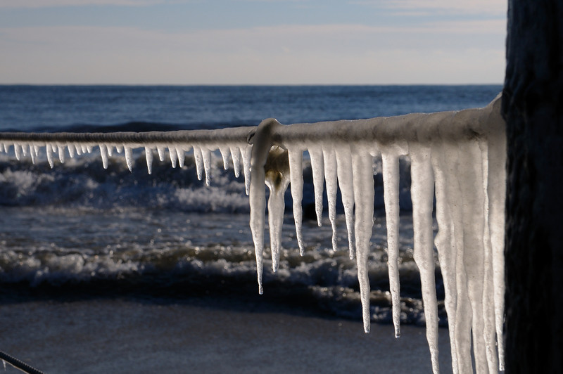 salt spray frozen on the Md/Va fence border......infused with sand.