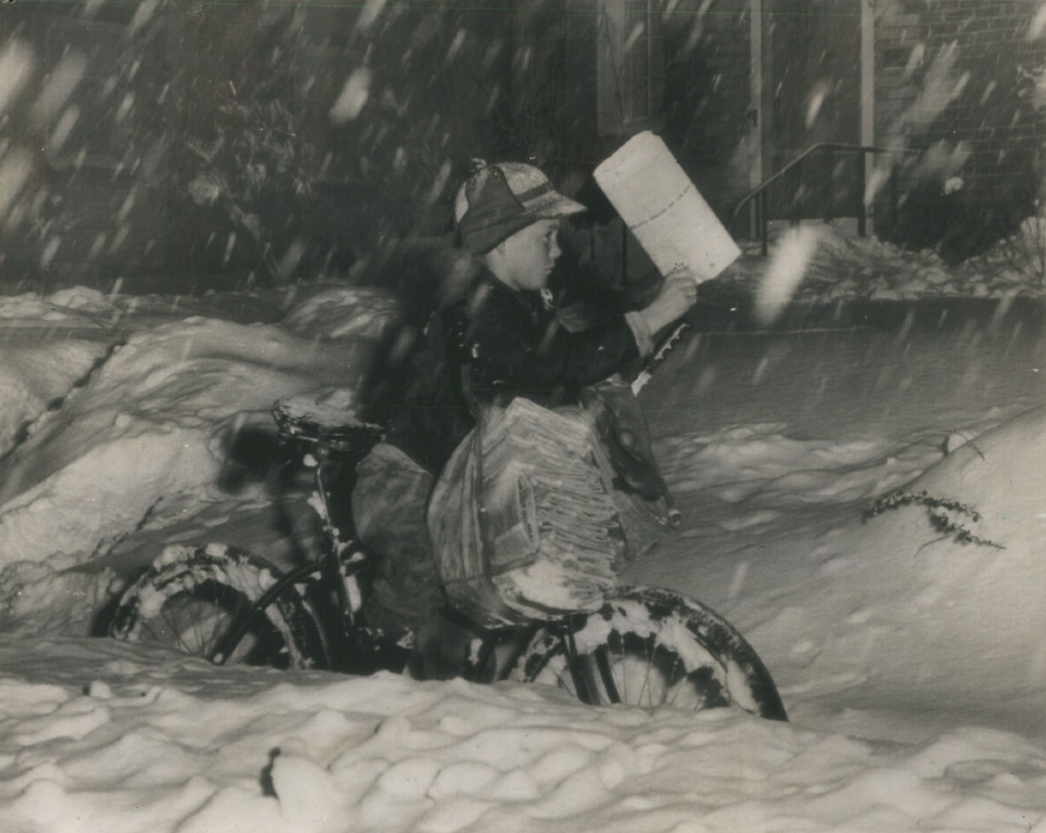 . Even the worst snowstorm in Denver in 33 years didn\'t stop Jerry Harrison (above) from covering his Denver Post Route.  Deep snow made his bicycle almost useless except to tote his newspaper bag. November 1946. (Associated Press)