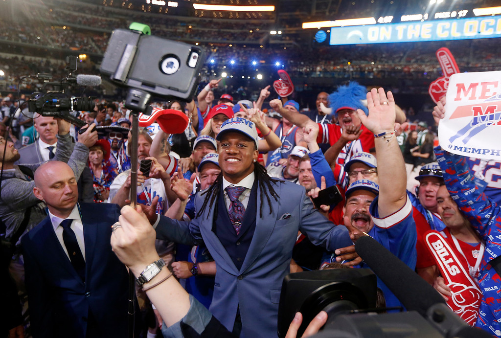 . Virginia Tech\'s Tremaine Edmunds celebrates with fans after being selected by the Buffalo Bills during the first round of the NFL football draft, Thursday, April 26, 2018, in Arlington, Texas. (AP Photo/Michael Ainsworth)