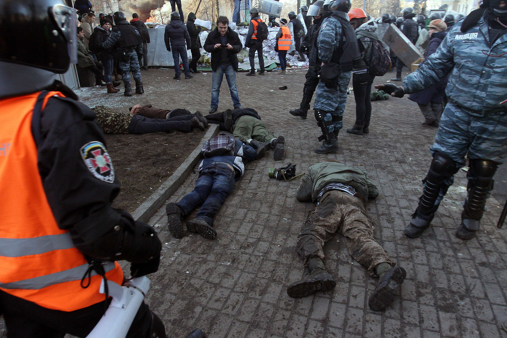 . Protesters clash with police in Kiev on February 18, 2014.  Ukrainian riot police stormed the main opposition camp in Kiev Tuesday after clashes left at least seven dead in the bloodiest day in three months of protests, triggering international alarm. AFP PHOTO/ ANATOLII  BOIKO/AFP/Getty Images