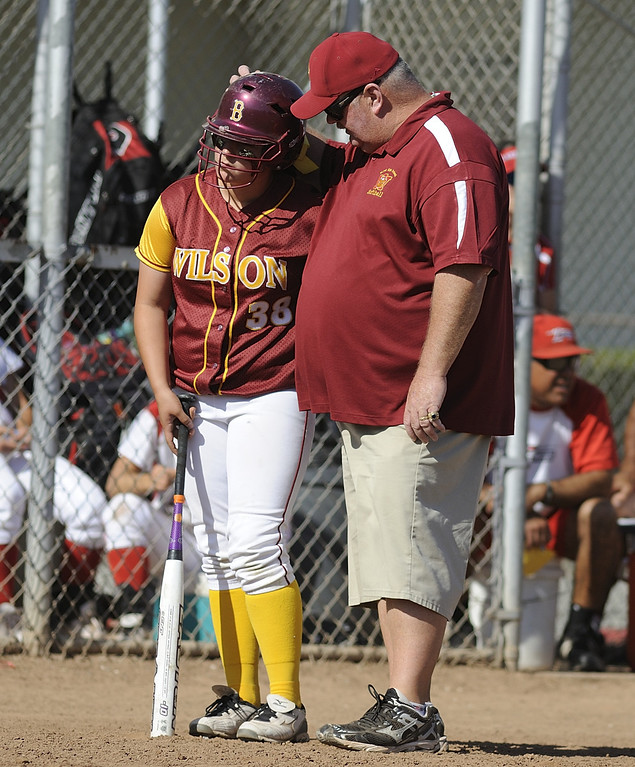 . LONG BEACH, CALIF. USA -- Wilson Head Coach Mike Hunter chats with Zoe Stavrou (38) against Lakewood in Lakewood, Calif., on May 2, 2013. Lakewood defeated Wilson 11-1 in five innings.  Photo by Jeff Gritchen / Los Angeles Newspaper Group