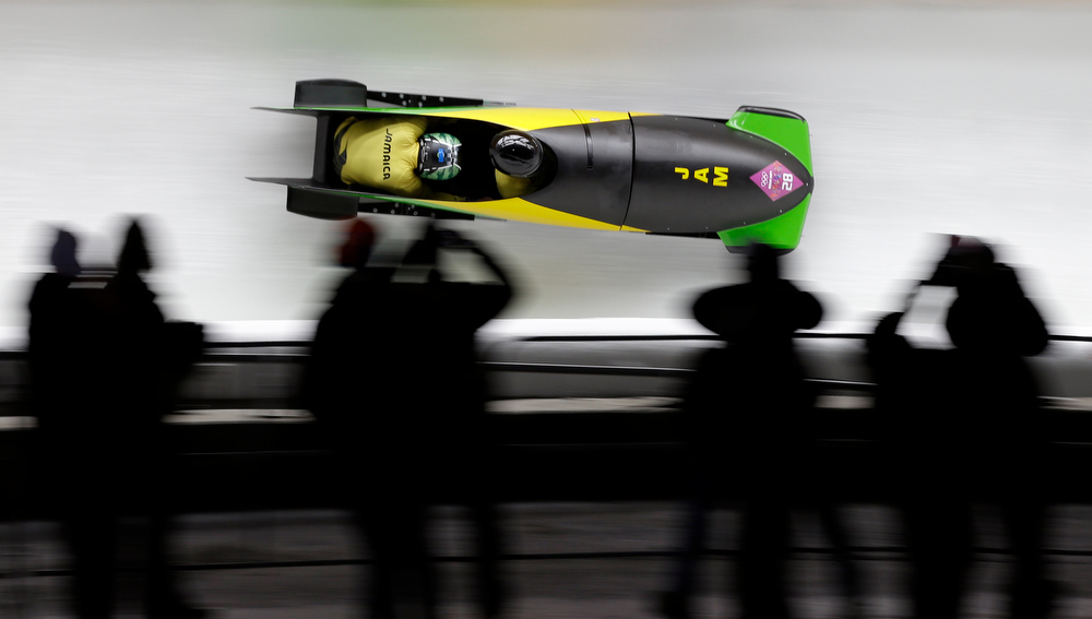. The team from Jamaica JAM-1, piloted by Winston Watts and brakeman Marvin Dixon, take a curve during the men\'s two-man bobsled competition at the 2014 Winter Olympics, Monday, Feb. 17, 2014, in Krasnaya Polyana, Russia. (AP Photo/Natacha Pisarenko)