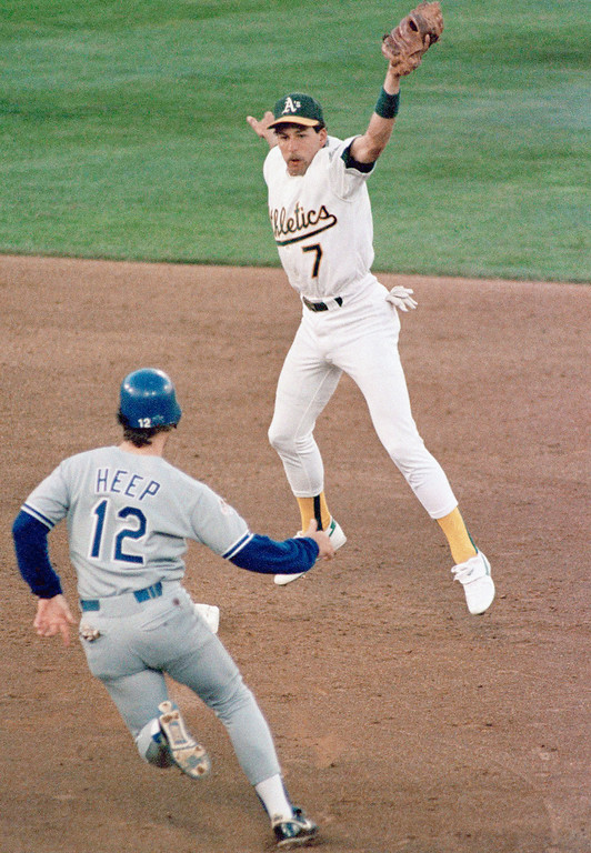 . Oakland A\'s Shortstop Walt Weiss leaps high to snare the throw from catcher Terry Steinbach for the second inning putout on Los Angeles Dodgers Danny Heep as he tried to steal second base in the fourth game of the World Series at Oakland Coliseum, Wednesday, Oct. 19, 1988. Weiss made several good fielding plays but also was charged with an error resulting in a Dodger run. (AP Photo/Sal Veder)