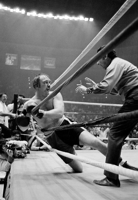 . Referee Tony Perez counts out challenger Chuck Wepner, from Bayonne, N.J., after he is knocked out by his opponent, defending heavyweight champion Muhammad Ali, in the 15th round of their title bout at the Richfield Coliseum, in Cleveland, Ohio, on March 24, 1975. (AP Photo)