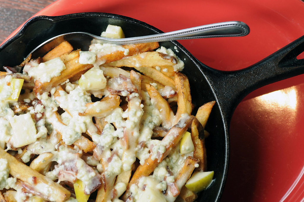 . Apple, Bacon and Blue Cheese Poutine, served in a skillet at the Red Cow. (Pioneer Press: Scott Takushi)