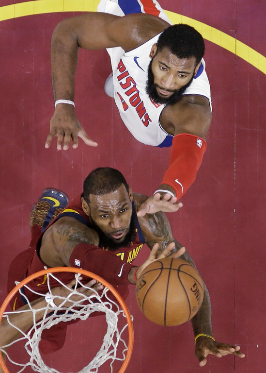 . Cleveland Cavaliers\' LeBron James, left, drives to the basket against Detroit Pistons\' Andre Drummond in the first half of an NBA basketball game, Sunday, Jan. 28, 2018, in Cleveland. The Cavaliers won 121-104. (AP Photo/Tony Dejak)