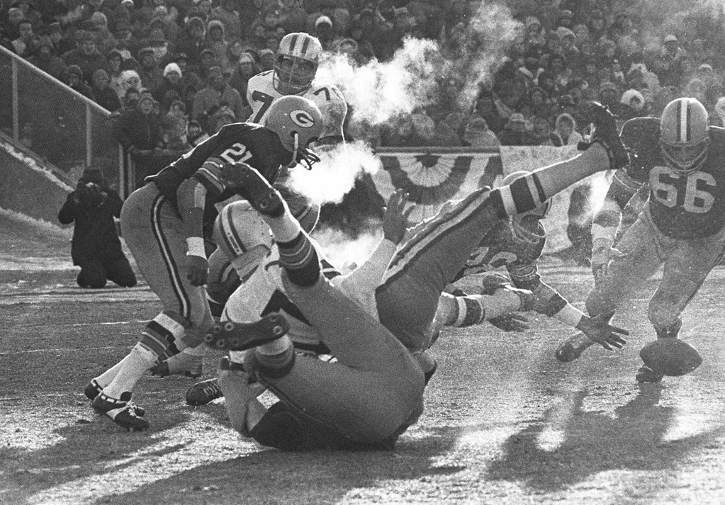 . Players spill in all directions as a fumble occurs in the third period of the National Football League Championship game between the Dallas Cowboys and the Green Bay Packers at Lambeau Field, in Green Bay, Wis., Sunday, Dec. 31, 1967.  Dallas quarterback Don Meredith (white jersey, #17) fumbles and Herb Adderley of the Packers (#26, partially hidden) reaches to recover it.  Played in sub-zero temperatures, the contest was later dubbed, \'The Ice Bowl.\' (AP Photo)