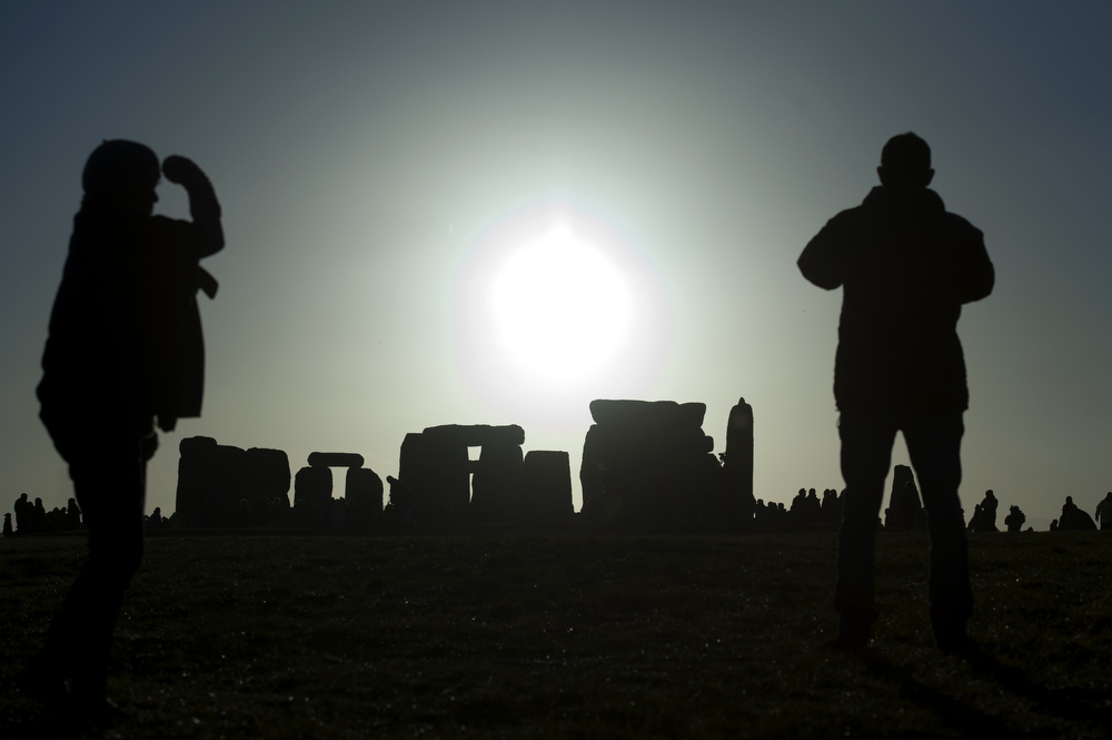 Description of . Revellers celebrate the pagan festival of 'Winter Solstice' at Stonehenge in Wiltshire in southern England on December 21, 2012. BEN STANSALL/AFP/Getty Images
