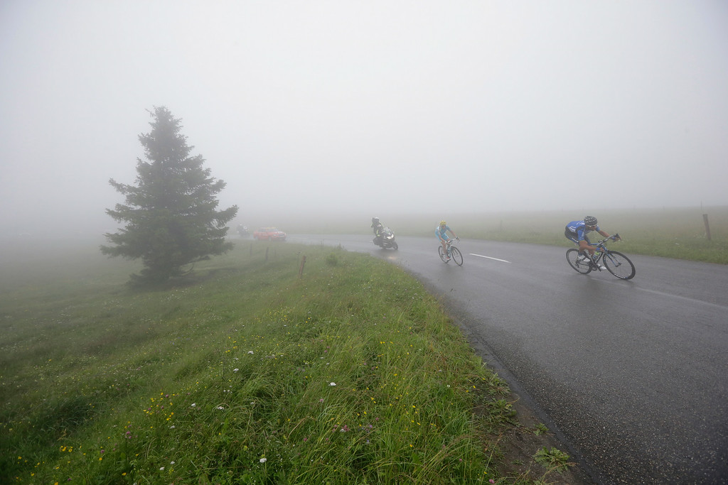 . Jan Barta of the Czech Republic, right, and Netherlands\' Lieuwe Westra during the tenth stage of the Tour de France cycling race over 161.5 kilometers (100.4 miles) with start in Mulhouse and finish in La Planche des Belles Filles, France, Monday, July 14, 2014. (AP Photo/Laurent Cipriani)