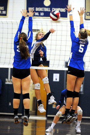 11/10/2018 Mike Orazzi   Staff Bristol Eastern's Zoe Lowe (7) and Tolland High School's Lily Daitch (33) and Alexis LaPorte (5) during the Class L Quarterfinal Girls Volleyball Tournament in Bristol Saturday.