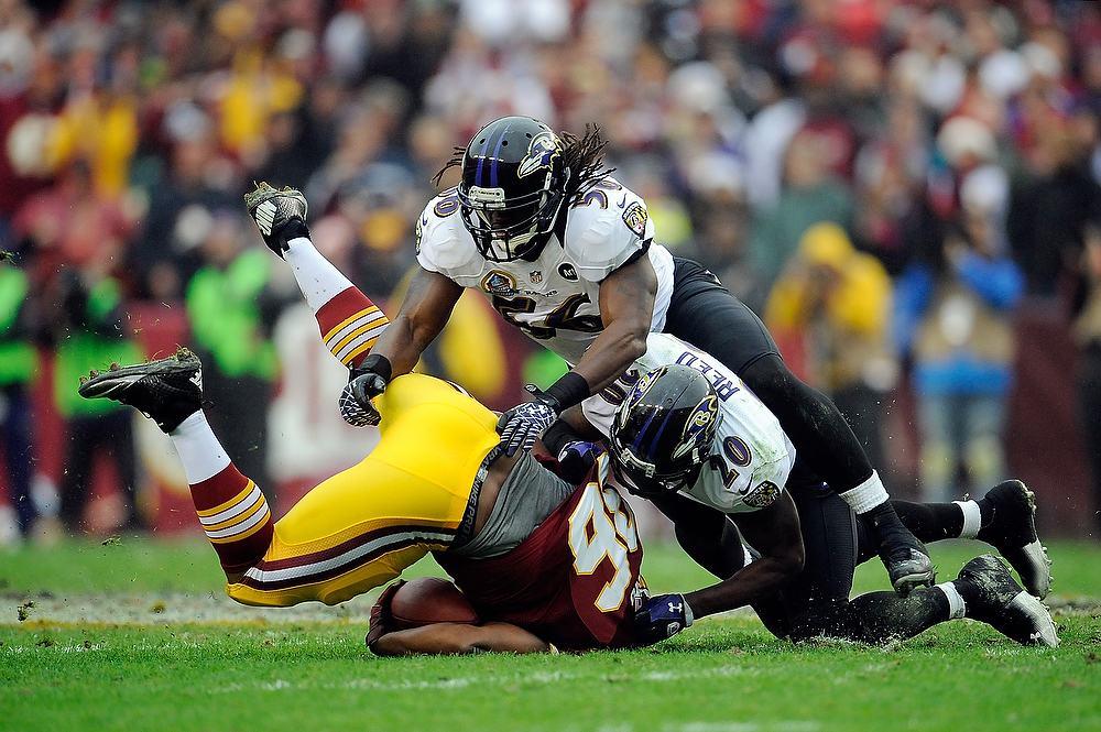 Description of . LANDOVER, MD - DECEMBER 09:  Darrel Young #36 of the Washington Redskins is tackled by Ed Reed #20 of the Baltimore Ravens during a game at FedExField on December 9, 2012 in Landover, Maryland.  (Photo by Patrick McDermott/Getty Images)
