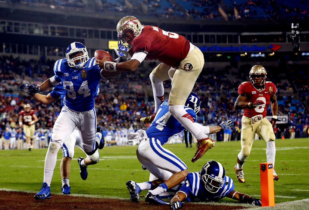 . Quarterback Jameis Winston #5 of the Florida State Seminoles scores a touchdown in the third quarter against the Duke Blue Devils during the ACC Championship game at Bank of America Stadium on December 7, 2013 in Charlotte, North Carolina.  (Photo by Streeter Lecka/Getty Images)