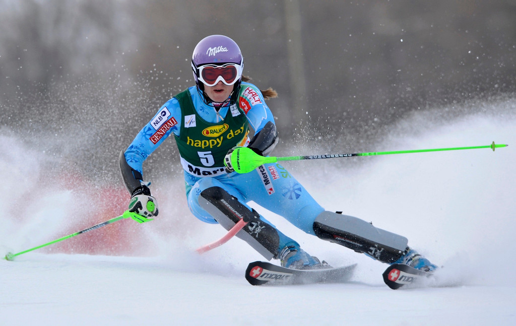 . Tina Maze of Slovenia clears a gate during the first run of the Alpine Skiing World Cup women\'s slalom ski race in Maribor January 27, 2013. REUTERS/Srdjan Zivulovic